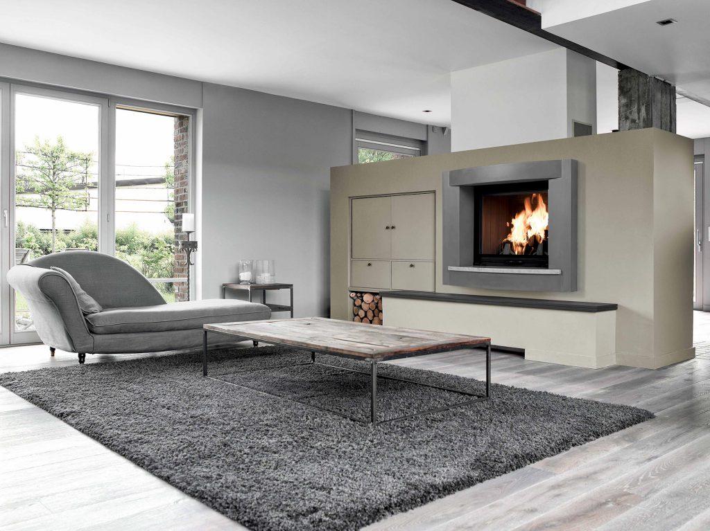 Pour habiller vos grands espaces, un cadre en pierre est une solution idéale. Contemporain et magnifique, cet habillage s'admire autant que le feu. Donnez-vie à vos soirées d'hiver devant cette cheminée majestueuse.